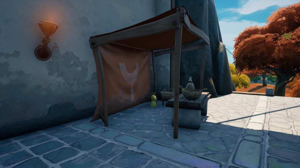 dónde encontrar artefactos dorados cerca de la aguja en Fortnite